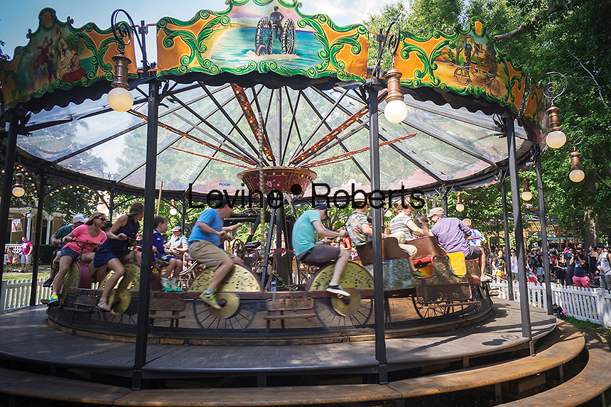A human-powered bicycle carousel from about 1897, one of only two still around, atFete Paradiso (Fête Paradiso) on Governor's Island in New York seen on Saturday, August 17, 2013. The festival features 19th and early 20th century vintage French carnival rides and games from the collections of Francis Staub and Regis Masclet. The rides and games are museum quality and this is the first time they have been collected together in one place. Visitors will be able to ride many of them until the exhibit festival closes on September 29, (© Richard B. Levine)