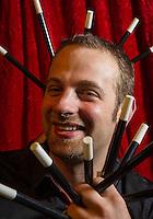 Cedric Reimon performing with magic wands during a photo-shoot for publicity purposes at the Double Fond, café-théatre de la magie (café and magic theatre), at 1, place du Marché Ste Catherine, 75004 Paris.
