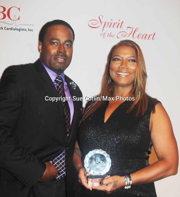 As The World Turns' Lamman Rucker is Master of Ceremonies at the 7th Annual Spirit of the Heart Awards - Dinner for the Association of Black Cardiologists honoring Queen Latifah and posing with Dr. Robert Gillespie on October 1, 2016 at Cipriani 42nd Street, New York City, New York. (Photo by Sue Coflin/Max Photos)