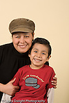 smiling portrait of 4 year old boy with his mother vertical