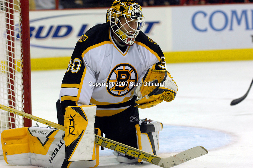 Boston Bruins' goalie Tim Thomas bounces a puck in his glove during a game with the Carolina Hurricanes Saturday, Feb. 3, 2007 at the RBC Center in Raleigh. Boston won 4-3 in overtime.