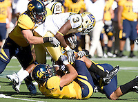 California defenders' Mike Mohamed and Sean Cattouse tackle Anthony Barr of UCLA during the game at Memorial Stadium in Berkeley, California on October 9th, 2010.   California defeated UCLA, 35-7.