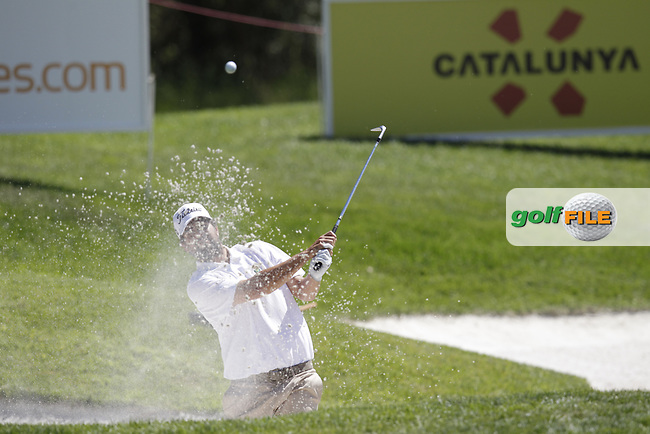 Gonzalo Gancedo Onieva (ESP) chips from a bunker at the 7th green during Thursday's Round 1 of the 2014 Open de Espana held at the PGA Catalunya Resort, Girona, Spain. Wednesday 15th May 2014.<br /> Picture: Eoin Clarke www.golffile.ie
