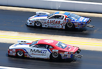 Sep 14, 2013; Charlotte, NC, USA; NHRA pro stock driver Greg Stanfield (near) races alongside Larry Morgan during qualifying for the Carolina Nationals at zMax Dragway. Mandatory Credit: Mark J. Rebilas-