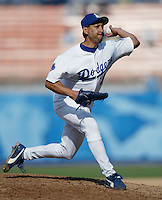 Jesse Orosco of the Los Angeles Dodgers pitches during a 2002 MLB season game at Dodger Stadium, in Los Angeles, California. (Larry Goren/Four Seam Images)