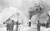 RGS rotary snowplow #2 clearing Durango yards, passing the ice house while several people look on.<br /> D&amp;RG  Durango, CO  Taken by Bryce, John - 1911