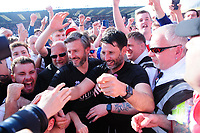 Lincoln City's assistant manager Nicky Cowley, left, and Lincoln City manager Danny Cowley celebtrate securing the League 2 Title<br /> <br /> Photographer Andrew Vaughan/CameraSport<br /> <br /> The EFL Sky Bet League Two - Lincoln City v Tranmere Rovers - Monday 22nd April 2019 - Sincil Bank - Lincoln<br /> <br /> World Copyright © 2019 CameraSport. All rights reserved. 43 Linden Ave. Countesthorpe. Leicester. England. LE8 5PG - Tel: +44 (0) 116 277 4147 - admin@camerasport.com - www.camerasport.com