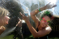 INDIO, CA-- APRIL 18, 2009--Brittany Bowerman, 20, left and Leslie Ventura, 19, are cooled off from the 100-degree heat by Bryan Foley, a member of the Do Lab Collective during the 10th annual Coachella Music and Arts Festival at the Empire Polo Field in Indio, April 18, 2009.