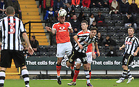 Luton Town captain Scott Cuthbert heads the ball clear during the Sky Bet League 2 match between Notts County and Luton Town at Meadow Lane, Nottingham, England on 29 October 2016. Photo by Liam Smith / PRiME Media