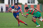 Sio Petelo heads across field as he tries to avoid Sosefo Kata. Counties Manukau Premier rugby game between Waiuku & Ardmore Marist played at Waiuku on Saturday May 10th 2008..Ardmore Marist won 27 - 6 after leading 10 - 6 at halftime.