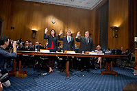 "From left to right: Acting United States Secretary of Homeland Security Elaine C. Duke; Christopher A. Wray Director, Federal Bureau of Investigation (FBI); and  Nicholas J. Rasmussen, Director, National Counterterrorism Center, Office of the Director of National Intelligence, are sworn-in to testify before the United States Senate Committee Homeland Security and Governmental Affairs on ""Threats to the Homeland"" on Capitol Hill in Washington, DC on Wednesday, September 27, 2017. Photo Credit: Ron Sachs/CNP/AdMedia"
