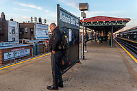 Astoria, New York 11 March 2016 - Passengers wait for the N train on an elevated platform in Queens.