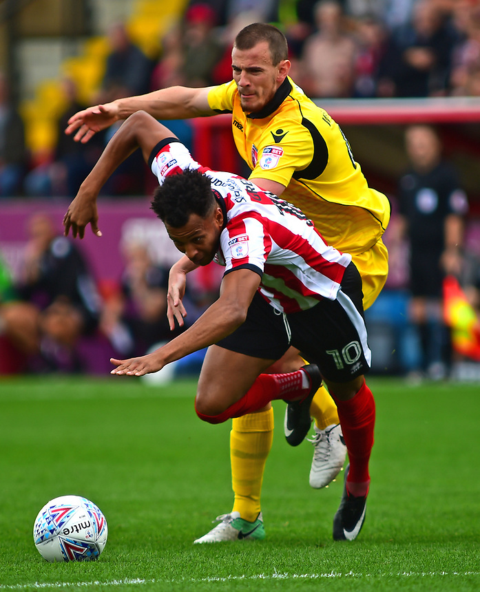 Lincoln City's Matt Green is fouled by Morecambe's Dean Winnard<br /> <br /> Photographer Andrew Vaughan/CameraSport<br /> <br /> The EFL Sky Bet League Two - Lincoln City v Morecambe - Saturday August 12th 2017 - Sincil Bank - Lincoln<br /> <br /> World Copyright &copy; 2017 CameraSport. All rights reserved. 43 Linden Ave. Countesthorpe. Leicester. England. LE8 5PG - Tel: +44 (0) 116 277 4147 - admin@camerasport.com - www.camerasport.com