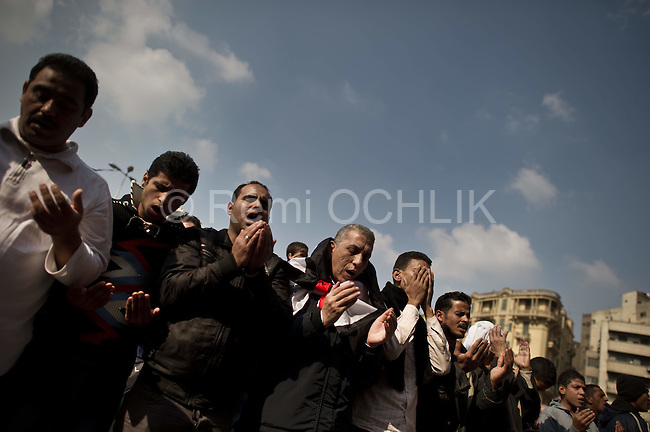 "Remi OCHLIK/IP3 -  Thousands of Egyptians perform Friday prayers during a rally in Tahrir Square in Cairo, Egypt, Friday, Nov. 25, 2011. Tens of thousands of protesters chanting, ""Leave, leave!"" are rapidly filling up Cairo's Tahrir Square in what promises to be a massive demonstration to force Egypt's ruling military council to yield power. The Friday rally is dubbed by organizers as ""The Last Chance Million-Man Protest,"" and comes one day after the military offered an apology for the killing of nearly 40 protesters in clashes on side streets near Tahrir over the last week"
