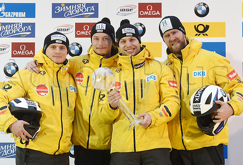 28.02.2016. Koenigssee, Germany.  German bobsled pilot Nico Walther (2.f.R.) holds up the World Cup combination victory trophy as he stands with his pushers Marko Huebenbecker (R), Christian Poser (L) and Eric Franke (2.f.L) at the Bobsled  World Cup in Koenigssee, Germany, 28 February 2016. Walther won fourth place in the race and first place in the combination overall at the World Cup.