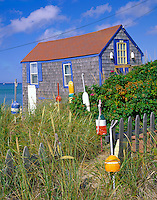 Cape Cod National Seashore, MA<br /> Pair of restored fishing shack with decorative lobster bouys - on the beach at Cape Cod Bay near Truro