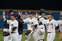 24 September 2009: Jon Weber, Buck Coats and Trevor Plouffe of Team USA are seen at the end of the 2009 Baseball World Cup final round match won 5-3 by Team USA over Cuba, in Nettuno, Italy.