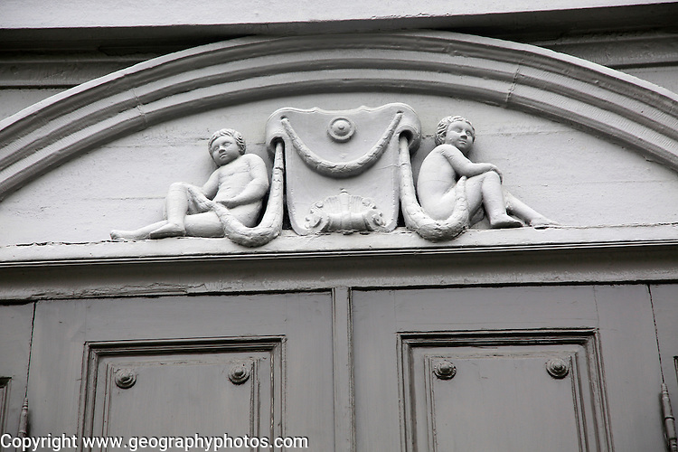 Details of cherub carvings, Stiftsgarden palace in city of Trondheim,  Norway