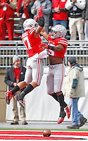Ohio State Buckeyes running back Jalin Marshall (17) celebrates with Ohio State Buckeyes running back Ezekiel Elliott (15) after the first Buckeye's TD at Ohio Stadium on 22, 2014. (Chris Russell/Dispatch Photo)