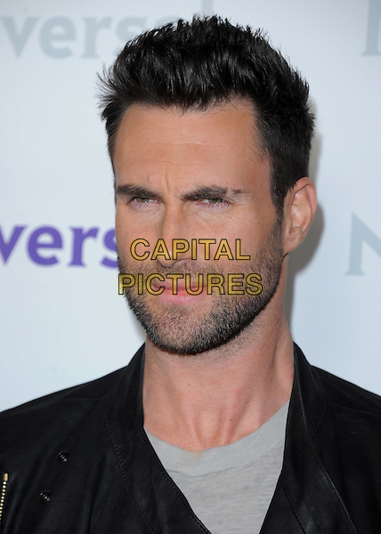 Adam Levine .at The NBC Universal Press Tour All-Star Party, The Athenaeum, Pasadena, California, USA, January 6th 2012..portrait headshot facial hair stubble black                                                                       .CAP/RKE/DVS.©DVS/RockinExposures/Capital Pictures.