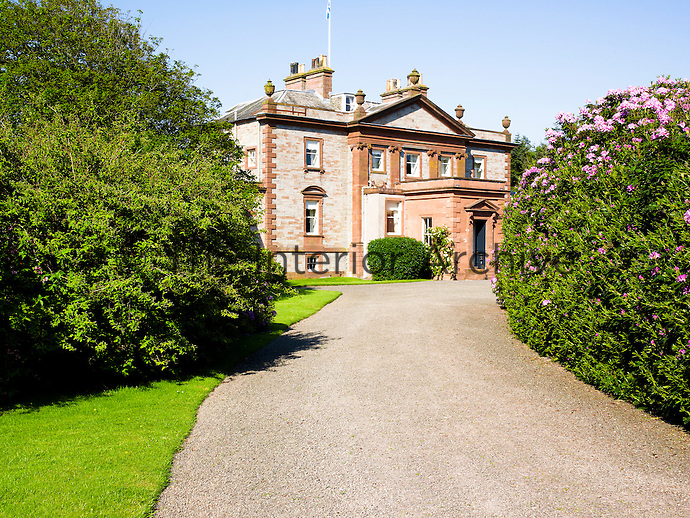 The driveway leading up to this 18th century country house is lined with rhododenron bushes