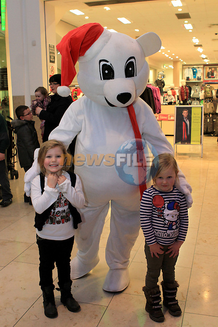 Ruby and Robyn as Santa arrives at Scotch Hall...(Photo credit should read Jenny Matthews www.newsfile.ie)....This Picture has been sent you under the conditions enclosed by:.Newsfile Ltd..The Studio,.Millmount Abbey,.Drogheda,.Co Meath..Ireland..Tel: +353(0)41-9871240.Fax: +353(0)41-9871260.GSM: +353(0)86-2500958.email: pictures@newsfile.ie.www.newsfile.ie.