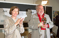 """Spanish actor FRANCISCO RABAL(R)  is presented a Special Grand Prize of the Americas by the World Film Festival'sVice President Daniele Cauchard (L) ,<br /> August 25th, 20001 in Montreal , Canada.<br /> <br /> <br /> Born in ¡guilas, Spain in 1925, Francisco Rabal . <br /> In 1950 he won his first real stage roles. Luis BuÒuel saw him in Historias de la radio and decided to cast him in the lead role of his new film to be shot in Mexico, NAZARÕN. This marked the beginning not only of Rabal's international career but also his lifelong friendship and collaboration with BuÒuel - including such masterpieces as VIRIDIANA (1961) and BELLE DU JOUR (1967).<br /> As a result of his performances in BuÒuel's early films, Rabal was sought after by many of the era's top international directors - Antonioni (THE ECLIPSE), Rivette (THE NUN), Visconti (THE WITCHES) - as well as directors of the so-called """"new Spanish cinema"""", in particular Carlos Saura, Miguel Picazo, Antonio Bardem and Jorge Grau. He made his American feature debut in 1977 in William Friedkin's SORCERER and won best actor awards at several festivals, including Cannes 1984 for his role in Mario Camus's THE HOLY INNOCENTS (!984) and the Montreal World Film Festival for his performance in Alain Tanner's THE MAN WHO LOST HIS SHADOW (1991).<br /> Rabal remained very active through the 1980s and 1990s, appearing in films by Pedro AlmÛdvar, Saura, Eliseo Subiela and Arturo Ripstein. In 1999 he played the title role in Saura's GOYA IN BORDEAUX shown at the 1999 Montreal Festival, a performance which won international critical acclaim.<br /> Rabal's cinematic heritage continues in the persons of his actress-daughter Teresa Rabal, director-son Benito Rabal and actor-grandson Liberto Rabal.<br /> <br /> Photo by Pierre Roussel / Getty Images News Service (ON SPEC)<br /> <br /> <br /> NOTE : Nikon D-1 JPEG opened with QUIMAGE ICC profile , saved as Adobe RG 1998 color space."""
