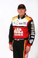 Feb 3, 2016; Chandler, AZ, USA; NHRA top fuel driver Doug Kalitta poses for a portrait during pre season testing at Wild Horse Pass Motorsports Park. Mandatory Credit: Mark J. Rebilas-USA TODAY Sports