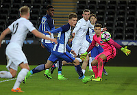 Pictured: Oli McBurnie of Swansea (in white C) crosses the ball past Nils Koerber and other Hertha Berlin players to Adam King (L) who score one of his three goals Tuesday 28 February 2017<br /> Re: Premier League International Cup, Swansea City U23 v Hertha Berlin II at at the Liberty Stadium, Swansea, UK