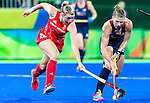 Katelyn Falgowski #23 of United States looks for a passing option while Lily Owsley #26 of Great Britain pursues during Great Britain vs USA in a women's Pool B game at the Rio 2016 Olympics at the Olympic Hockey Centre in Rio de Janeiro, Brazil.