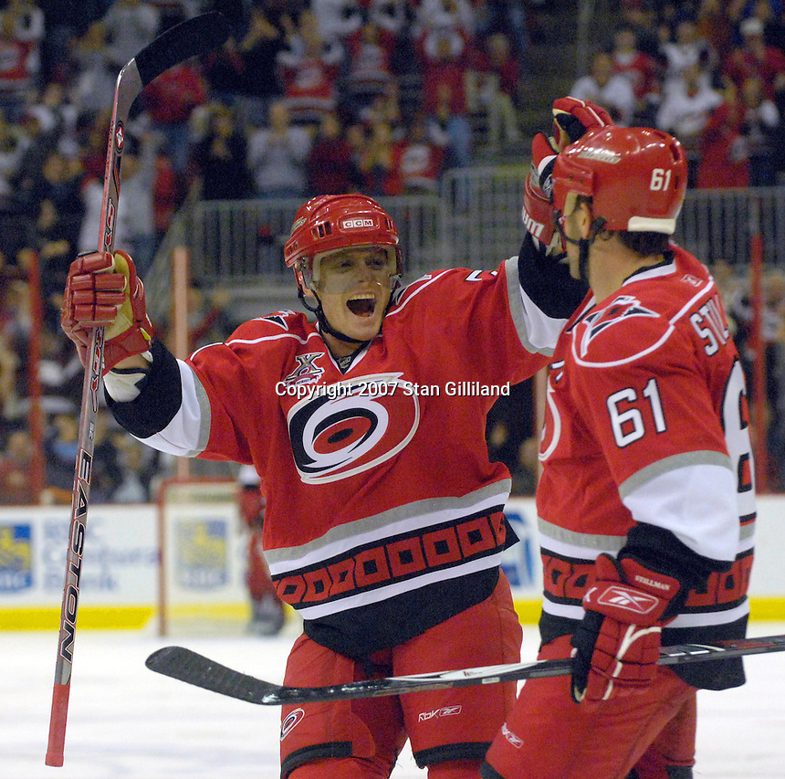 The Carolina Hurricanes' Jeff Hamilton and Cory Stillman (61) celebrate a third period goal against the Philadelphia Flyers Wednesday, Nov. 21, 2007 in Raleigh, NC. The Flyers won 6-3.