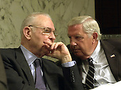 Washington, DC - April 8, 2004 -- 9/11 Commission Vice Chairman Lee Hamilton, left, shares some thoughts with Fred Fielding during the testimony of Doctor Condoleezza Rice, National Security Advisor, before the commission in Washington, D.C. on April 8, 2004.<br /> Credit: Ron Sachs / CNP<br /> [RESTRICTION: No New York Metro or other Newspapers within a 75 mile radius of New York City]