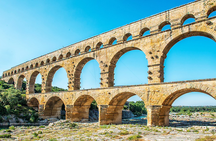 The Pont du Gard is a Roman aqueduct built in the 1st century AD, as part of a 50-kilometer aqueduct system. It crosses the Gardon River in southern France. It is a World Heritage site and one of the most popular tourist attractions in Europe.
