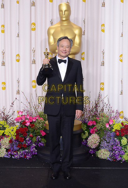 Ang Lee.85th Annual Academy Awards held at the Dolby Theatre at Hollywood & Highland Center, Hollywood, California, USA..February 24th, 2013.pressroom oscars full length black tuxedo white shirt award winner trophy .CAP/ADM/RE.©Russ Elliot/AdMedia/Capital Pictures.