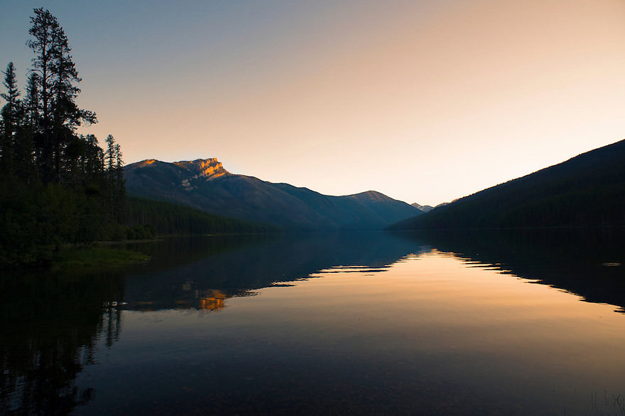 The last light of the day sets on Charlotte Peak and Big Salmon Lake in Montana's Bob Marshall Wilderness.