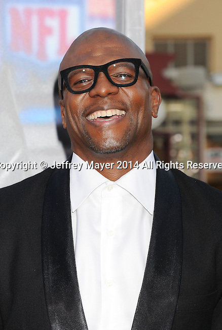 WESTWOOD, CA- APRIL 07: Actor Terry Crews attends the Los Angeles premiere of 'Draft Day' at the Regency Village Theatre on April 7, 2014 in Westwood, California.