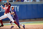 OKLAHOMA CITY, OK - JUNE 04: Sis Bates #22 of the Washington Huskies tags out Dani Morgan #1 of the Florida State Seminoles during the Division I Women's Softball Championship held at USA Softball Hall of Fame Stadium - OGE Energy Field on June 4, 2018 in Oklahoma City, Oklahoma. (Photo by Shane Bevel/NCAA Photos via Getty Images)