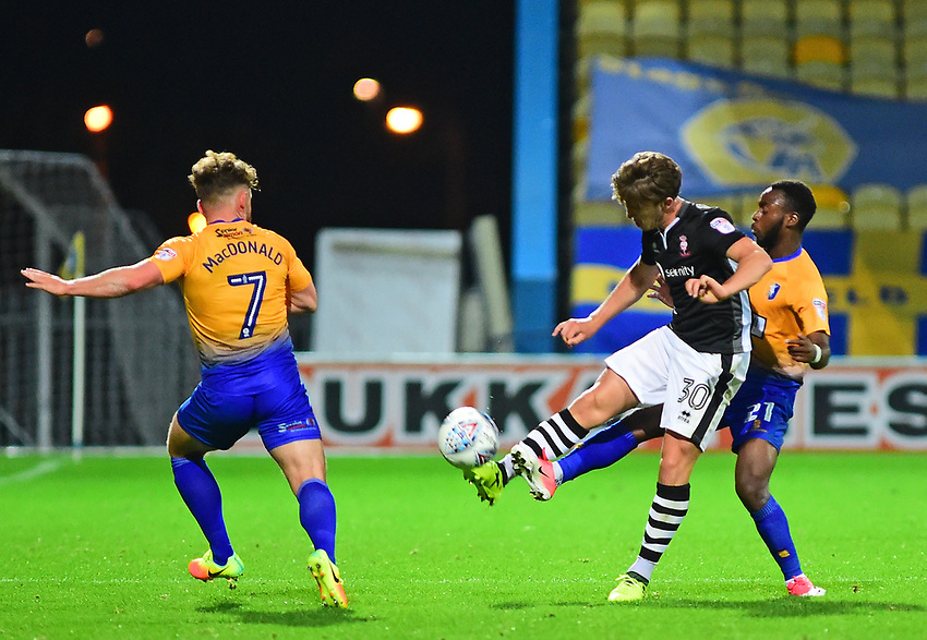 Lincoln City's Alex Woodyard vies for possession with Mansfield Town's Omari Sterling-James and Alex MacDonald<br /> <br /> Photographer Andrew Vaughan/CameraSport<br /> <br /> The EFL Checkatrade Trophy - Mansfield Town v Lincoln City - Tuesday 29th August 2017 - Field Mill - Mansfield<br />  <br /> World Copyright &copy; 2018 CameraSport. All rights reserved. 43 Linden Ave. Countesthorpe. Leicester. England. LE8 5PG - Tel: +44 (0) 116 277 4147 - admin@camerasport.com - www.camerasport.com