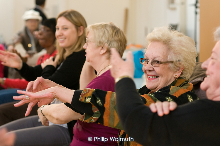Chair-based exercise at a health promotion event for the over-50s at Greenside Community Centre organised by Central London Youth Development and the Lisson Green Tenants' and Residents' Association.