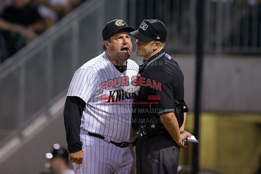 Charlotte Knights manager Julio Vinas (45) argues with home plate umpire Chris Segal after being ejected in the 7th inning of the game against the Lehigh Valley Iron Pigs at BB&T BallPark on June 3, 2016 in Charlotte, North Carolina.  The Iron Pigs defeated the Knights 6-4.  (Brian Westerholt/Four Seam Images)