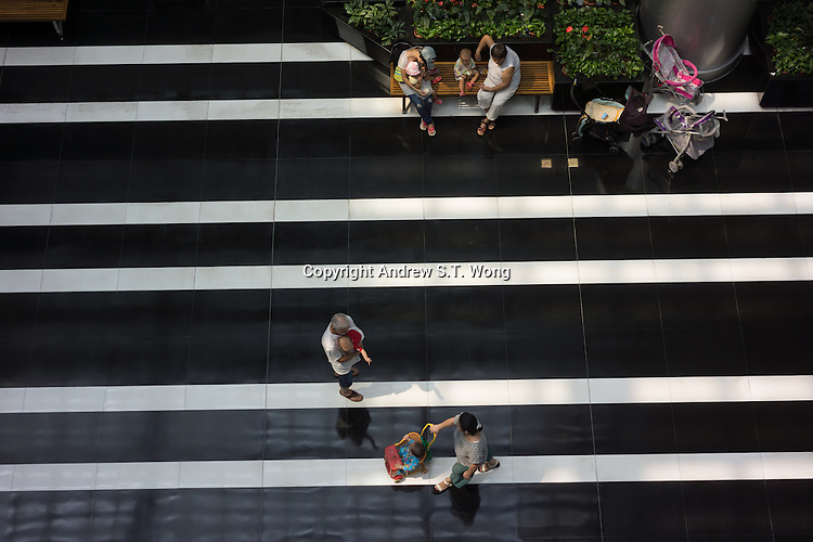 Chinese rest at the foyer of the 24-hour Dongguan Library in Dongguan, Guangdong province, China, August 2016.