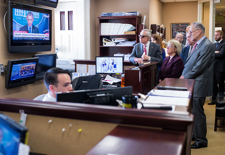 UNITED STATES - JUNE 18: From left, Senate Minority Leader Harry Reid, D-Nev., Sen. Patty Murray, D-Wash., Senate Minority Whip Dick Durbin, D-Ill., and Sen. Chuck Schumer, D-N.Y.,  watch President Barack Obama speak about the shooting in Charleston before holding their news conference in the Senate Radio/TV Gallery on budget negotiations on Thursday, June 18, 2015. (Photo By Bill Clark/CQ Roll Call)