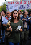 "A woman makes noise with a casserole and a wooden hammer as she takes part in a ""casserole march"" against government's austerity reforms and the public payment of bank's debts on October 13, 2012 in Madrid. © Pedro ARMESTRE"