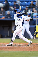 Asheville Tourists first baseman Sean Bouchard (13) swings at a pitch during a game against the Rome Braves at McCormick Field on April 17, 2018 in Asheville, North Carolina. The Tourists defeated the Braves 1-0. (Tony Farlow/Four Seam Images)