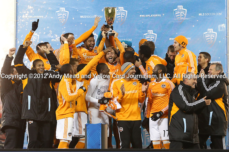 18 November 2012: Houston's Brad Davis holds the Eastern Conference Trophy overhead while celebrating with teammates and coaches. DC United played the Houston Dynamo at RFK Stadium in Washington, DC in the second leg of their 2012 MLS Cup Playoffs Eastern Conference Final series. The game ended in a 1-1 tie, Houston won the series 4-2 on aggregate goals.