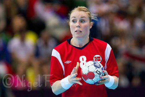 28 JUL 2012 - LONDON, GBR - Karoline Dyhre Breivang (NOR) of Norway looks for a way through the French defence during the women's London 2012 Olympic Games Preliminary round handball match at The Copper Box in the Olympic Park, in Stratford, London, Great Britain (PHOTO (C) 2012 NIGEL FARROW)