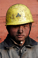 Portrait of a dock worker at a shipping depot that supplies the local power plants in Shanghai, China. ©Qilai Shen/Sinopix