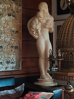 "The statue in the corner of the living room is called ""Two Sisters"" by Kai Nielsen"