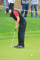 Ross Fisher (ENG) putts on the 5th green during Saturay's Round 3 of the 2014 BMW Masters held at Lake Malaren, Shanghai, China. 1st November 2014.<br /> Picture: Eoin Clarke www.golffile.ie