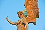 The Quadriga dell'Unita; horses and winged victory statue on top of the Altare della Patria monument in Rome; quadriga is a chariot drawn by 4 horses